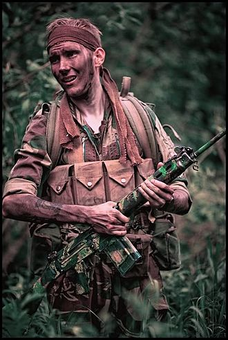 Rhodesian Security Forces - A re-enactor portrays a Rhodesian Light Infantry trooper, circa 1979. The primary infantry weapon of the Rhodesian Army was the FN FAL battle rifle, which was camouflaged as seen here.