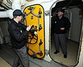 Members of the Navy's Board of Inspection and Survey (INSURV) inspect a armored door during a community relations project aboard the retired battleship USS Wisconsin (BB 46), Norfolk, Va., Jan. 25, 2013 130125-N-ZO696-036.jpg