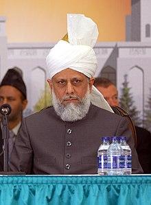 Ahmad posing, wearing a turban