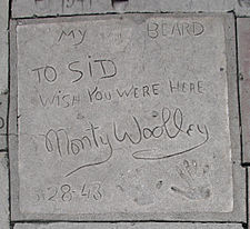 "Monty Woolley's concrete tile showing, from the top, the words ""My beard"" adjoining his beard imprint, the inscription ""To Sid [Grauman] Wish you were here"", his signature, the date ""5-28-43"", and his handprints"
