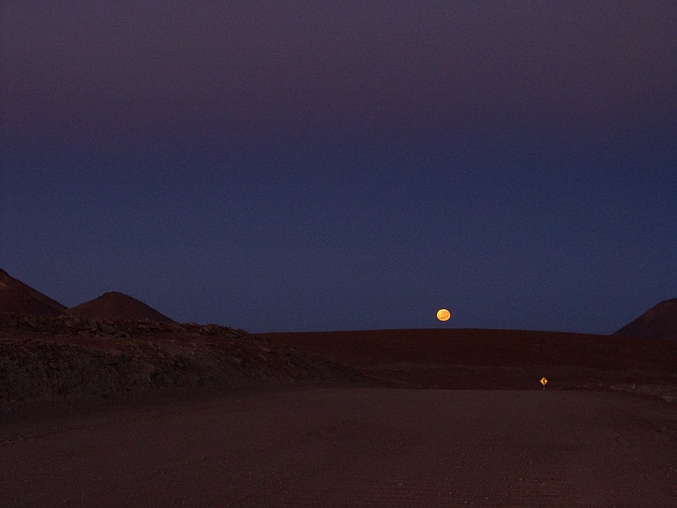 Moonrise above the 12 metres wide access road to the ALMA High Site