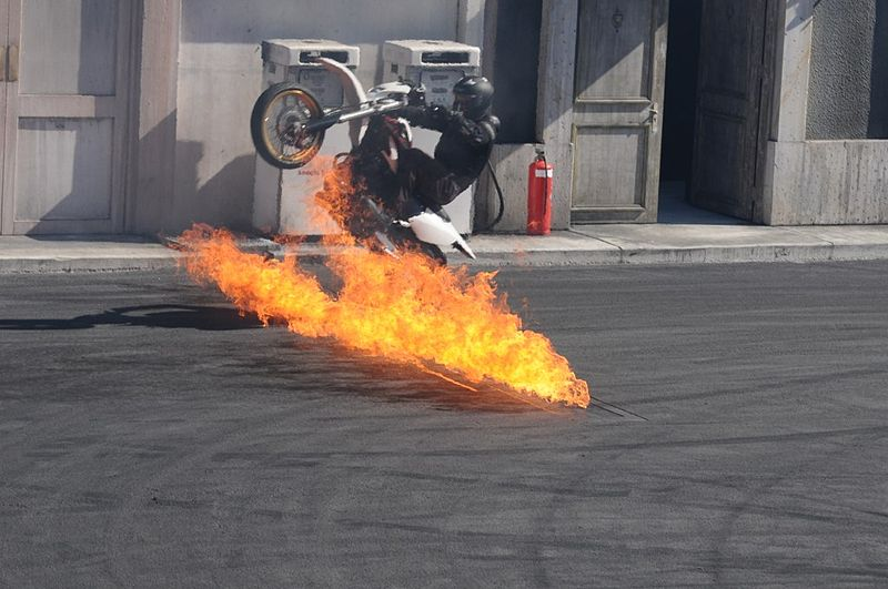 File:Motorbike driving through fire at Hollywood Stunt Driver.jpg