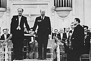 Sergei Prokofiev (on the podium, right) receiving applause after the second performance of his Symphony No. 6.