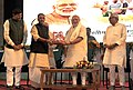 Narendra Modi being welcomed on his arrival, at the 87th ICAR Foundation Day Celebrations, at Patna, Bihar. The Union Minister for Agriculture, Shri Radha Mohan Singh, the Chief Minister of Bihar.jpg