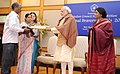 Narendra Modi presenting the National Bravery Awards 2015 to the children, in New Delhi on January 24, 2016. The Union Minister for Women and Child Development, Smt. Maneka Sanjay Gandhi is also seen (18).jpg