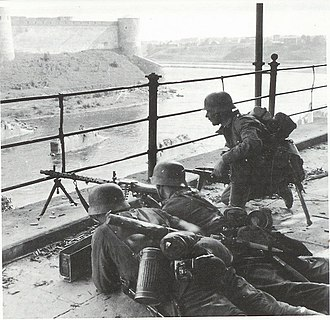 Battle of Narva (1944) - Soldiers defending the Estonian bank of the Narva River, with the fortress of Ivangorod on the opposite side.