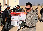 National Guardsmen distribute school supplies DVIDS342540.jpg