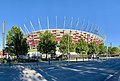 National Stadium in Warsaw seen from a street, Poland, 2019.jpg