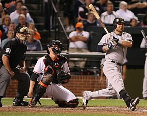 Nick Swisher batting in a game between the New...