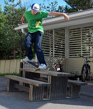 Skateboarding styles - A skateboarder making use of street furniture.