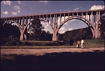 OHIO HIGHWAY 82 BRIDGE SPANS THE CUYAHOGA VALLEY AND THE OHIO-ERIE CANAL BEYOND THE WALKERS, NEAR CLEVELAND, OHIO.... - NARA - 557969.jpg