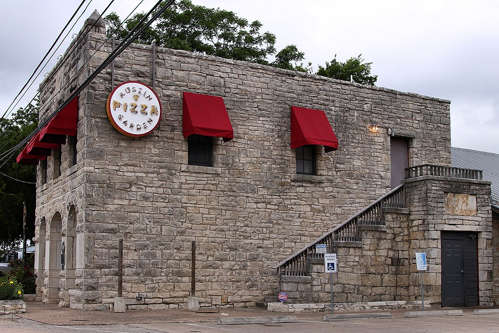 exterior of the austin pizza garden limestone building from the side. built in the 1800s, this building is among those haunted in austin