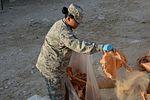 Operation Community, Volunteers clean house 151201-F-YM354-105.jpg
