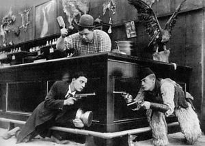 Roscoe Arbuckle - Arbuckle's nephew Al St. John (right) with Buster Keaton and Arbuckle in Out West (1918).