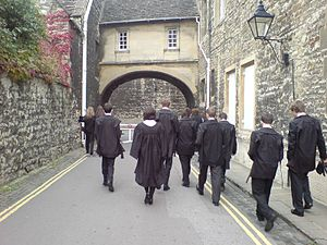 New College Lane - Eastern end of New College Lane near the entrance to New College, with Oxford University undergraduates in academic dress.