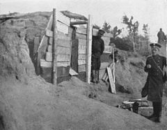 P217a Released convict in his cave dug out of the sandhill.The Pristav on the right.jpg