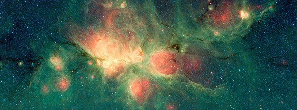 "The Cat's Paw Nebula lies inside the Milky Way Galaxy and is located in the constellation Scorpius. Green areas show regions where radiation from hot stars collided with large molecules and small dust grains called ""polycyclic aromatic hydrocarbons"" (PAHs), causing them to fluoresce. (Spitzer space telescope, 2018) PIA22568-CatsPawNebula-Spitzer-20181023.jpg"
