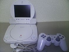 PSone with LCD screen and a DualShock controller