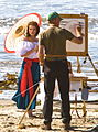 Painter with his beautiful female subject in Spanish dress.jpg