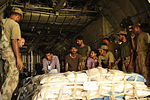 Pakistani soldiers and U.S. Airmen from the 746th Expeditionary Airlift Squadron unload cargo from a C-130 Hercules aircraft in Pakistan Aug. 22, 2010, during humanitarian relief efforts to flood-stricken 100822-F-KV470-372.jpg