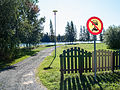 Park in Huhtala, Seinäjoki, Finland, with Kyrkösjärvi reservoir in the background.jpg