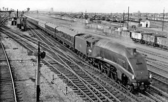LNER Class A4 - No. 60034 Lord Faringdon hauling a train at Peterborough railway station in 1959.