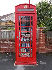 Red telephone box wikipedia decommissioned phone box converted into a mini library whitwell isle of wight uk reheart Choice Image