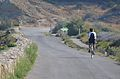 Photo by Jarmo Majorin. November in Peyriac de Mer, France. Woman on bike. Sunny road..jpg