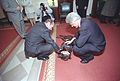 Photograph of President William Jefferson Clinton and President Jacques Chirac of France Petting Buddy the Dog- 02-19-1999 (6461540955).jpg