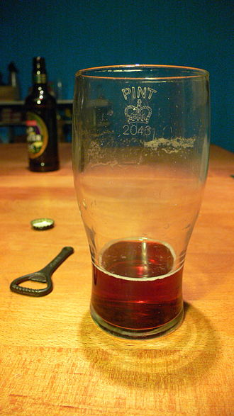 "Pint glass - ""Tulip"" shaped glass, showing Crown stamp."