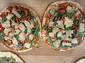 Pizza with cherry tomatoes, mushrooms and arugula.jpg