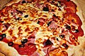 Pizza with ham, pepperoni, olive and onion.jpg