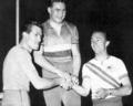 Podium de poursuite cycliste individuelle aux JO de Melbourne, 1er Michel Rousseau (Fr), 2e G. Pesenti (It), 3e R. Ploog (Aus).png