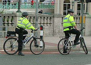 Police bicycle - British police officers on custom Smith & Wesson bicycles