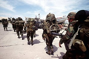 Combat Aviation Brigade, 10th Mountain Division - Soldiers of the 10th Mountain Division secure Port-au-Prince International Airport in 1994.