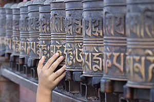 Prayer wheel - A little boy rolling the prayer wheels at Swayambhunath, Nepal.