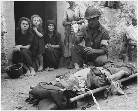 Private Roy W. Humphrey of Toledo, Ohio is being given blood plasma after he was wounded by shrapnel in Sicily on 9 August 1943. Private Roy W. Humphrey of Toledo, Ohio is being given blood plasma after he was wounded by shrapnel in Sicily on 8-9-43 - NARA - 197268.jpg