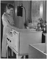 "REA, TVA, ""Woman standing over stove"" - NARA - 195871.tif"