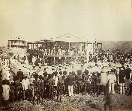 British annexation of southeast New Guinea in 1884 Reading the proclamation of annexation, Mr Lawe's house, Port Moresby, New Guinea, November 1884 - photographer John Paine or Augustine E. Dyer (5708761723).jpg