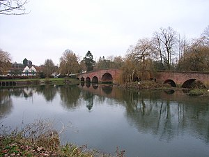 Great House at Sonning - Modern view of the Great House on the left and Sonning Bridge on the right from the opposite bank of the River Thames.