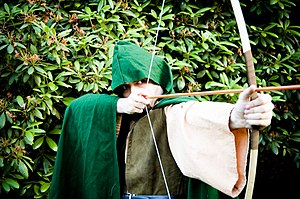 Man dressed as Robin Hood.
