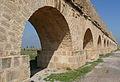 Roman aqueduct arches near Carthage.jpg