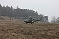 Romanian soldiers provide security around a Slovenian army UH-1Y Super Huey helicopter during a mission rehearsal exercise at the Joint Multinational Readiness Center in Hohenfels, Germany, March 18, 2013 130318-A-IR813-003.jpg