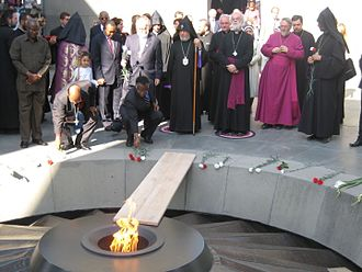 Rowan Williams - Williams and Catholicos of All Armenians Karekin II at the Armenian Genocide monument in Yerevan for a torch lighting ceremony for the genocide victims in Darfur. The two men are standing on purple cloth.