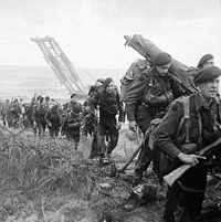 Royal Marine Commandos attached to 3rd Division move inland from Sword Beach on the Normandy coast, 6 June 1944. B5071