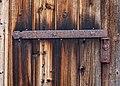 Rusty hinge of weather worn barn gate.jpg