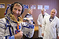 STS-135 Chris Ferguson undergoes a fit check of his Sokol suit.jpg