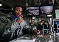Sailor keeps track of planes DVIDS357413.jpg