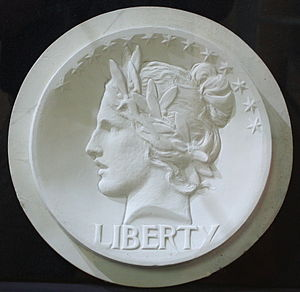 Lincoln cent - Saint-Gaudens model for the cent obverse. With an Indian headdress added, the design was later developed for the eagle.