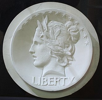 Lincoln cent - Saint-Gaudens model for the cent obverse. With an Indian headdress added, the design was later developed for the gold eagle coins.